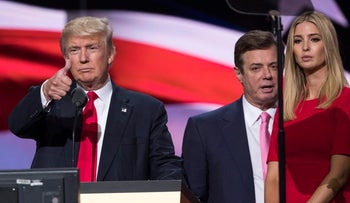 Then-Trump Campaign manager Paul Manafort stands between Republican presidential candidate Donald Trump and daughter Ivanka Trump at the Republican National Convention in Cleveland on July 21, 2016.