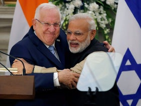 Israeli President Reuven Rivlin and India's Prime Minister Narendra Modi hug each other after reading their joint statement at Hyderabad House in New Delhi, India, November 15, 2016