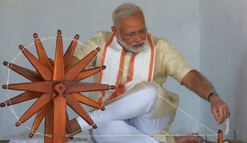 India's Prime Minister Narendra Modi spins cotton on a wheel during his visit to Gandhi Ashram in Ahmedabad, India, June 29, 2017. REUTERS/Amit Dave TPX IMAGES OF THE DAY
