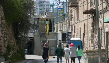 Palestinians walking on a street in the West Bank city of Hebron, April 2017.