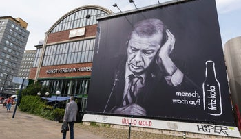 An advertising board of the beverage producer Fritz Kola depicting Turkish President Recep Tayyip Erdogan can be seen  in Hamburg, Germany, June 29. 2017. Words in German read: Wake Up, Man.