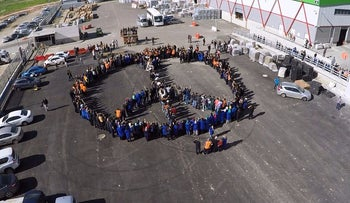 This picture shows the employees of SodaStream forming a peace symbol outside the company's plant in Israel. Feb. 29, 2016