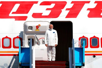 Indian Prime Minister Narendra Modi disembarks from his plane upon his arrival at Ben-Gurion International airport near Tel Aviv on July 4, 2017.