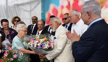 India's prime minister receives flowers while on a visit in Israel