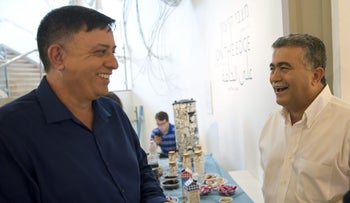 Avi Gabbay, left, who finished second in first round of July 4 Labor Party primary, and Amir Peretz, who finished first, in Tel Aviv, July 3, 2017.