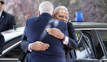 Israeli President Reuven Rivlin and Indian Prime Minister Narendra Modi embrace during a welcome ceremony at the president's official residence in Jerusalem on July 5, 2017.