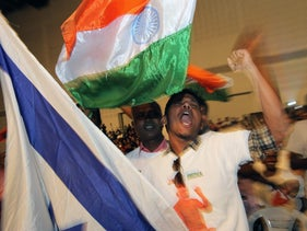 Indians wave an Indian and an Israeli flag at a Narendra Modi-headlined event in Tel Aviv, July 5, 2017