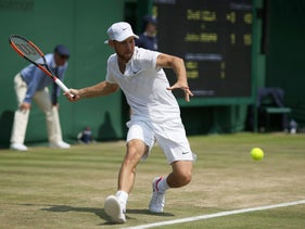 Israel's Dudi Sela plays a return during his Men's Singles Match against John Isner of the United States on day four at the Wimbledon Tennis Championships in London Thursday, July 6, 2017.