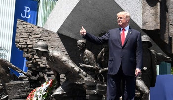 U.S. President Donald Trump poses in front of the Warsaw Uprising Monument on Krasinski Square in Warsaw, Poland, July 6, 2017.