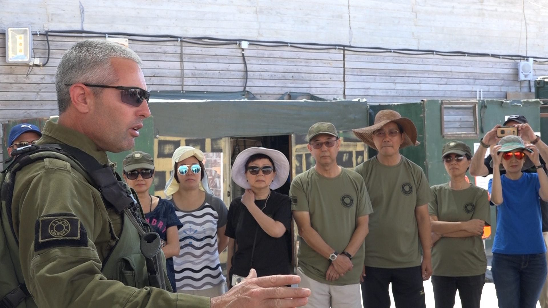 An instructor teaching tourists from Hong Kong at the Caliber 3 counterterrorism and security training academy, July 2017.