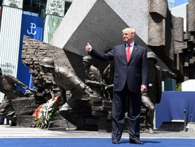 U.S. President Donald Trump holds his thumb up as he poses in front of the Warsaw Uprising Monument. July 6, 2017