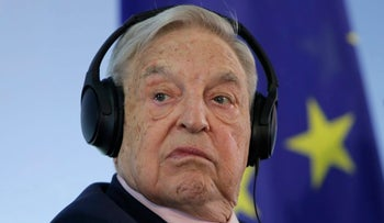 Hungarian-American investor George Soros attends a press conference prior to the launch event for the European Roma Institute for Arts and Culture at the Foreign Ministry in Berlin, Germany, Thursday, June 8, 2017. (AP Photo/Ferdinand Ostrop)