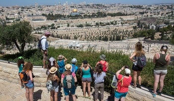Tourists observing the Mount of Olives in Jerusalem, May 2017.