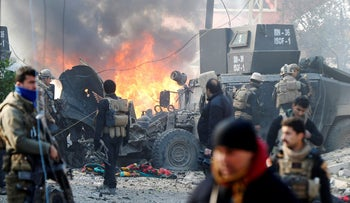 File photo: Iraqi Special Operations Forces react after a car bomb exploded during an operation in Mosul, Iraq, January 16, 2017.