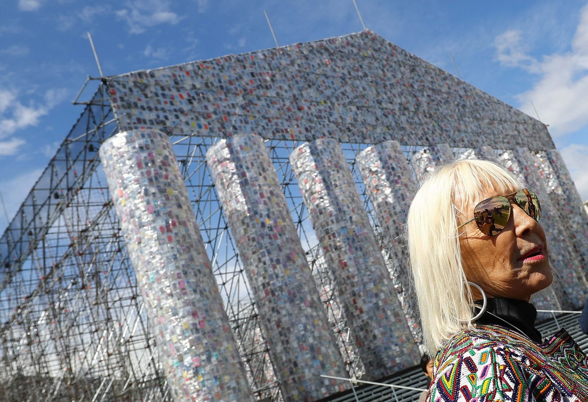 """Artist Marta Minujin poses in front of her art project """"Temple of books"""" ahead of the opening of Germany's biggest art fair """"Documenta 14"""" in Kassel, Germany, June 7, 2017."""