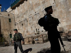 Israeli security officials stand guard at the Tomb of the Patriarchs in Hebron, January 2013.