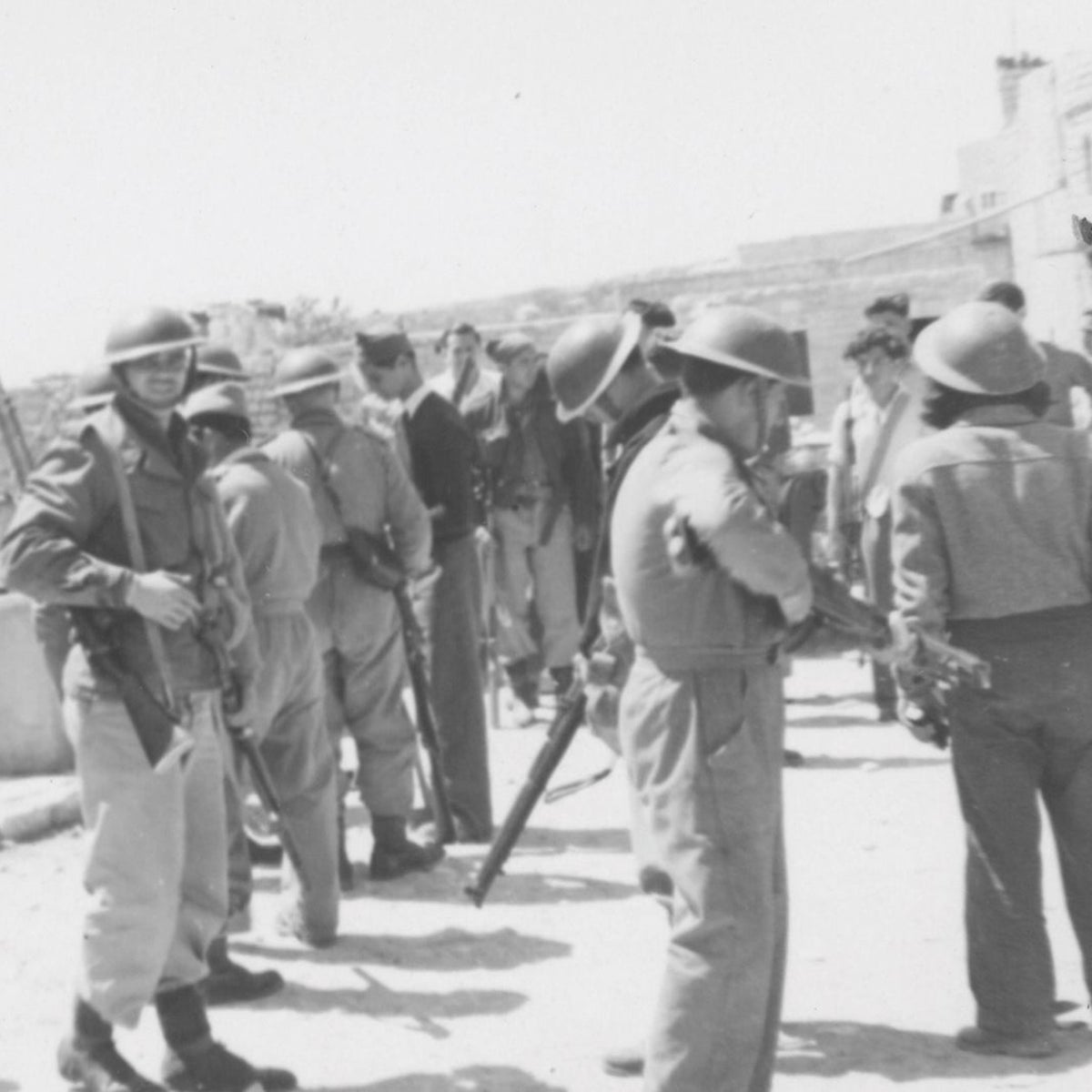 Fighters from Israel's pre-state militia occupying the village of Deir Yassin, April 1948.