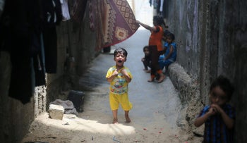 A Palestinian boy cries outside his family's house in Khan Younis refugee camp in the southern Gaza Strip. July 11, 2017