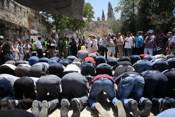 Worshipers at the entrance to the Temple Mount complex in Jerusalem's Old City, July 16, 2017.