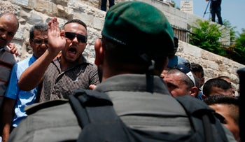 Israeli security forces scuffle with Palestinian protesters outside Lions Gate, at the entrance to Al-Aqsa the Temple Mount, Jerusalem's Old City, on July 17, 2017.