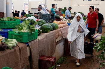A women buying vegetables on the first day of the holy fasting month of Ramadan at a market in Tunis, Tunisia, May 27, 2017.