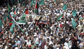 Jordanians carry a model of the Dome of the Rock mosque during a demonstration, called for by the Islamic Action Front, in Amman following Friday prayers on July 21, 2017,
