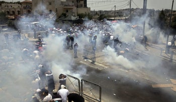 Israeli security forces clash with Palestinians in East Jerusalem, July 21, 2017.
