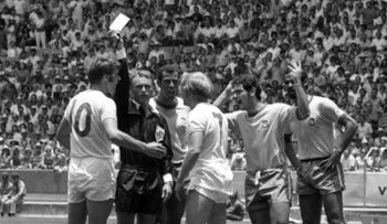 Israeli referee Abraham Klein, second left, stands his ground against British players' protestation during a World Cup match between England and Brazil in Guadalajara, Mexico on June 7, 1970.
