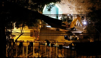 Israeli security forces stand next to heavy machinery as metal detectors at the entrance to the Temple Mount are removed, Jerusalem, Israel, July 25, 2017.