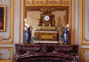 The clock on the mantle over the fireplace, a gift to Prince Charles-Joseph from Marie Antoinette.