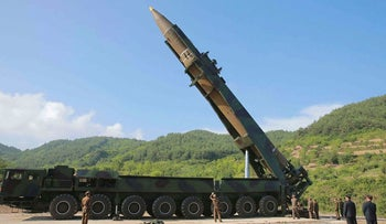 In this July 4, 2017, file photo distributed by the North Korean government, North Korean leader Kim Jong Un, second from right, inspects the preparation of the launch of a Hwasong-14 intercontinental ballistic missile