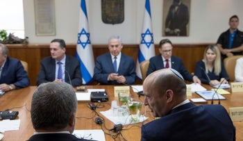Israeli Minister of Education Naftali Bennett speaks with Defence Minister Avigdor Lieberman during the weekly cabinet meeting at the prime minister's office in Jerusalem on July 23, 2017.