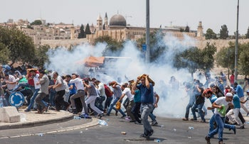 Clashes between Muslim worshippers and Israeli forces at Friday afternoon prayers in Jerusalem outside Al-Aqsa Mosque on July 14, 2017.