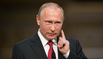 File photo: Russian President Vladimir Putin gestures as he speaks during a news conference with French President Emmanuel Macron at the Palace of Versailles, near Paris, May 29, 2017.