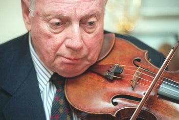 Isaac Stern plays his violin at his studio in New York, in 1997.