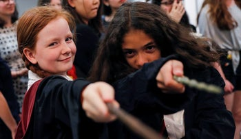 Harry Potter fans pose for a photograph at an anniversary presentation at Waterstones bookshop in London, Britain June 26, 2017.