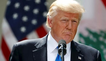 President Donald Trump listens to a question during a joint news conference with Lebanese Prime Minister Saad Hariri in the Rose Garden of the White House in Washington, Tuesday, July 25, 2017
