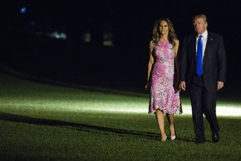 U.S. President Donald Trump and U.S. First Lady Melania Trump walk across the South Lawn of the White House in Washington, D.C. on Tuesday, July 25, 2017.