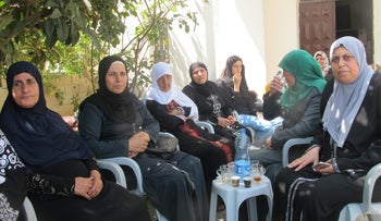 The mother, Abtisam al-Jalil (second from left) at her home with woman from her village a few days after the attack
