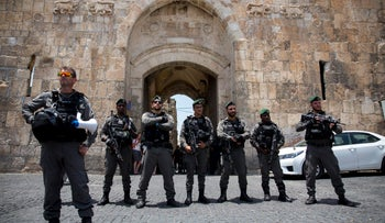 FILE PHOTO: Israel officers block the entrance to the Lions Gate in Jerusalem. July 14, 2017