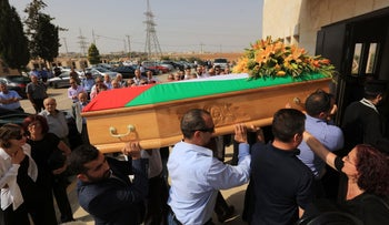 Jordanian mourners attend a funeral of Bashar Hamarneh, a doctor who was in the residential quarter of the Israeli embassy at the time of an attack on the weekend, during his funeral in Madaba on July 27, 2017, after he died of his injuries.