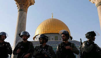Israeli security forces stand at the compound known to Muslims as Noble Sanctuary and to Jews as Temple Mount, after Israel removed all security measures it had installed at the compound, and Palestinians entered the compound in Jerusalem's Old City July 27, 2017.