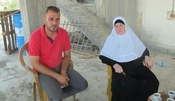 Abbas Barghouti and his mother Adiba at home in the West Bank village of Kobar, July 2017.