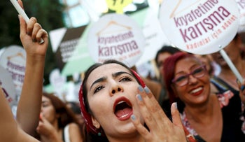 Women rights activists shout slogans during a protest against what they say are violence and animosity they face from men demanding they dress more conservatively, in Istanbul, Turkey, July 29, 2017. REUTERS/Murad Sezer