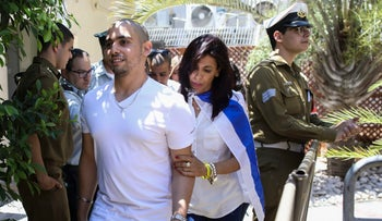 Elor Azaria escorted by his mother arrives to Israeli military court in Tel Aviv, July 30, 2017.