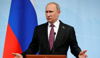 Russian President Vladimir Putin speaks during a news conference after the G20 summit in Hamburg, northern Germany, July 8, 2017.