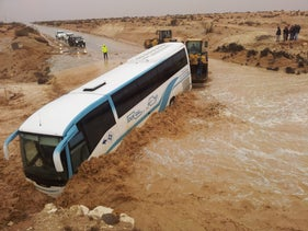 A bus is stuck on a flooded road in the Negev desert, October 2013.