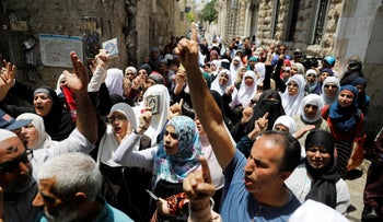 Palestinians shout slogans during a protest over the new security measures at the Al-Aqsa compound in Jerusalem's Old City, July 20, 2017.
