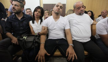 Elor Azaria at his appeal judgment between his mother Oshra and father Charlie
