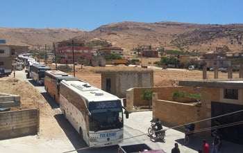 A transport convoy for Syrian jihadists and their families enters the Arsal region as part of the Hezbollah, Nusra Front ceasefire deal, July 31, 2017.